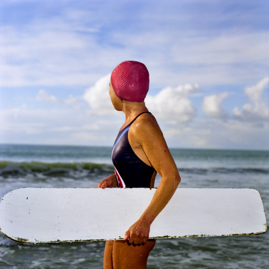 cornwall women with boady board and red hat.jpg