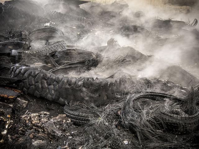21.Piles of burnt truck tires.